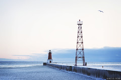 A Cool Breeze (KineticBear) Tags: christmas morning winter sky lighthouse lake snow tower ice birds wisconsin clouds sunrise river michigan seagull greenbay tradition menominee jacobmiller kineticbear