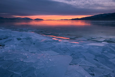 The Final Breakthrough (Adam's Attempt (at a good photo)) Tags: pink sunset mountain lake mountains cold color reflection ice water colors clouds reflections grey utah nikon colorful cloudy clear utahlake utahcounty d90 colorfulsunset lr4 iceoff utahlakesunset thefinalbreakthrough