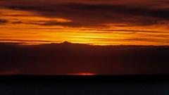 IMG_1994 The orange opening (Rodolfo Frino) Tags: sunrise amanecer salidadelsol nubes clouds redclouds yellowclouds horizon sea mar horizonte cielo rodolfofrino