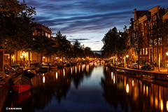 Amsterdam. (alamsterdam) Tags: amsterdam keizersgracht evening longexposure reflections bridge water boats sky