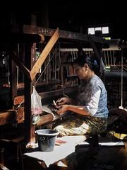 Spinning Jenny (Feldore) Tags: myanmar loom weave weaving burma burmese traditional inle lake woman weaver feldore mchugh em1 olympus documentary 1240mm factory scarves