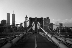 never forget. new york, ny. 2001. (eyetwist) Tags: eyetwistkevinballuff eyetwist bw film analog newyork brooklynbridge wtc worldtradecenter twintowers newyorkcity manhattan ny nyc brooklyn bridge buildings silhouette wires cables tower suspension walkway 2001 pedestrian landmark eastriver bigapple infrastructure crossing famous scansfromthearchives ishootfilm ishootkodak trix tx400 tx 400 nikonfa nikon fa nikkor50mmf14ais nikkor 50mm blackwhite black white kodak symmetry symmetric monochrome americana flag neverforget f14 ais 400tx kodaktrix400400tx