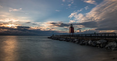 Charlevoix Lighthouse (Kevin Povenz) Tags: 2016 august kevinpovenz michigan charlevoix lighthouse lighhouse lakemichigan beach lakeshore rocks longexposure sunset canon7dmarkii clouds sun evening rain stormy weather blue