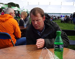 Explaining a difficult concept (Snapshooter46) Tags: stokesleyshow man explaining difficultconcept thought idea waterbottle