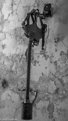 Hanging gas mask (Dave and Jodi Piddington) Tags: chernobyl ukraine holiday decay abandonedbuildings death history nucleardisaster accident travel dark tourism darktourism photography architecture nuclear disasters adventure kiev blackandwhite