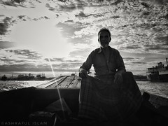 Alone under the sky! (Ashrafl) Tags: sky boat alone travel rural summer clouds ocean river boatman scenic outdoor sunset twilight