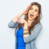 Surprised woman finger pointing on copy space. (mike499312) Tags: woman surprised surprise girl face amazemant white beautiful portrait young isolated happy female mouth excited background show pointing finger caucasian open expression people beauty adult looking person shocked hair attractive brunette one model shock pretty cheerful amazed emotion fun cute human studio head hand joy blue long posing