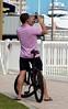 Waterfront Biker (LarryJay99 ) Tags: city urban hairy man male men guy bike bicycle photographer waterfront legs masculine manly guys dude flipflops dudes earplugs stud studs virile braghettoni ilobsterit