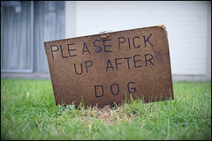 """Please pick up after dog"" (Eric Flexyourhead (YVR catch-up mode!)) Tags: city urban canada detail green grass sign vancouver wooden bc bokeh britishcolumbia westend handwritten fragment harostreet panasoniclumix20mmf17 olympusem5"