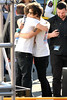 Harry Styles shares a hug with a band member after exchanging gifts One Direction seen having lunch and exchange gifts outside the CBS Studios, before the taping of the 'X Factor' finale. Los Angeles, California- 20.12.12 JP