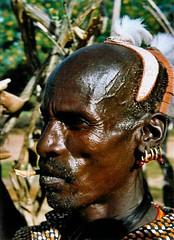Hamar Warrior (Sascha Grabow) Tags: africa portrait orange man beard necklace chief feathers earring tribal sash ohr ear sascha getty warrior afrika omovalley sasha sasa ethiopia bandana sg ethnic ebony pippen afrique krieger garbo halsband tribu riftvalley omo eastafrica thiopien ostafrika kopfschmuck akazie halskette seitenansicht grabow cawa ethnie satcha sasch grabo sgcom ethnica tribalwarrior sevencontinents gettycontributor gettyimagesartist saschagrabowcom lehmfrisur