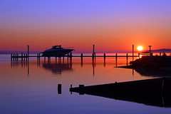 winter sunrise (scott1346) Tags: blue orange water colors yellow sunrise boat still dock silhouettes maryland 1001nights patuxentriver sandgates absolutelyperrrfect 1001nightsmagiccity onlythebestofnature ringexcellence dblringexcellence tplringexcellence flickrstruereflection1 flickrstruereflection2 flickrstruereflection3
