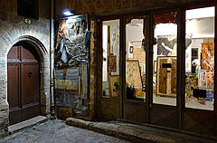 galerie d'art (horlo) Tags: door wallpaper france art night facade vintage french geotagged frankreich europe paintings shops porte francia roussillon nuit languedoc tableaux hrault boutiques fonddcran pzenas