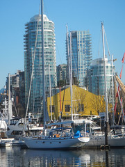 Docks at Granville Island (DJ Greer) Tags: city morning winter reflection building water sunshine vancouver sailboat creek buildings reflections island harbor boat apartments cityscape bc apartment bright harbour granville bridges condo highrise mast false