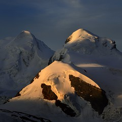 Castor & Pollux (pierre hanquin) Tags: blue light shadow summer sky sun mountain snow mountains alps color colour nature colors berg rose montagne alpes sunrise landscape geotagged rouge schweiz switzerland soleil nikon europa europe colours suisse couleurs swiss bleu cie