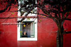 The Conversation (Dave G Kelly) Tags: old windows red woman house holiday building tree portugal window canon photographer phone apartment lisboa lisbon sheets communication elderly conversation talking alfama dwelling communicating davegkelly canoneos5dmark2 copyright2013davegkelly