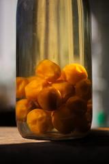 Bouteille I (haijee13) Tags: mirabelle alcool alcohol bouteille bottle dtail soleil lumire grande ouverture orange verre