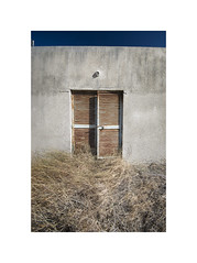 Cracked (Furious Zeppelin) Tags: furiouszeppelin fz cyprus nikon d80 metal door grass hut broken cracked