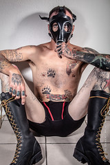 IMG_2980 (DesertHeatImages) Tags: red axle leather gas mask piggy boy tattoos naked nude chaser lgbt versatile