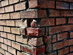1 Brick Corner (Mertonian) Tags: 2sides bricks walls crumbling corner cracking mertonian robertcowlishaw canon powershot g7x mark ii canonpowershotg7xmarkii texture light dark lunchwalk red interesting noon mismatch