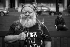 Aye! (Leanne Boulton) Tags: people monochrome urban street candid portrait portraiture streetphotography candidstreetphotography candidportrait eyecontact candideyecontact streetlife streetportrait scottish man male beard face facial expression eyes look emotion feeling event protest rally independence character tone texture detail depthoffield bokeh natural outdoor light shade shadow city scene human life living humanity society culture canon 7d 50mm black white blackwhite bw mono blackandwhite glasgow scotland uk