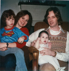 Me (Faith Goble) and He Who Shall Remain Nameless with Neice and Nephew (circa 1982) (faith goble) Tags: family woman usa baby man art children 1982 couple child kentucky joke faith young superman retro american oldphoto products dork hairspray bowlinggreen badfashion mousse sweatervest 80shair helmethead smle goble faithgoble goofyhairstyle narrowjaw