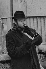 seattle urban blackandwhite bw white man black male hat vertical contrast standing scarf canon person reading book downtown image cigarette coat streetphotography science smoking westlake 7d wa washingtonstate rf stockphoto rm 247028 royaltyfree rightsmanaged sciencia