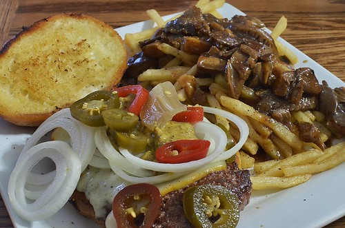 Mmm... cheeseburger with onions and pick by jeffreyw, on Flickr