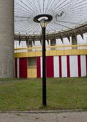 Flushing Meadows (LaurenChapman) Tags: park newyorkcity abandoned grass architecture modern fairgrounds streetlight circus pavement halo fair structure flushingmeadows queens architect lamppost pavilion philipjohnson worldsfair laurenchapman lptouching