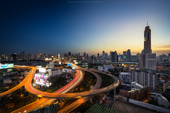 Bangkok Cityscape (: : T O N I : :) Tags: city bridge blue light sky reflection building tower water skyline architecture modern night skyscraper river landscape thailand hotel boat town office twilight construction highway asia downtown cityscape view traffic state bangkok space capital transport illumination landmark center business thai getty gettyimages