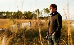 Defiance (csteinmetz1) Tags: portrait guy beach yellow reeds jeans goldenhour defiance 50mmf18 nikond90