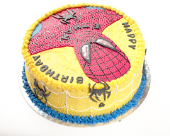 Spiderman Cake Ethan III (Doha Sam) Tags: birthday red party white home cooking yellow cake digital umbrella studio nikon raw flash spiderman indoors diffuser doha qatar d80 strobist lumopro colorperfect perfectraw samagnew smashandgrabphotocom lp160 colorpos wwwsamagnewcom maketiff