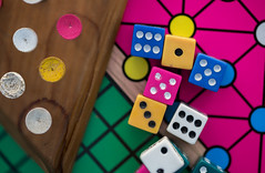 (donna leitch) Tags: macro game dice canon100mmf28lmacro canon5dmarkiii donnaleitch triangularpegsolitaire pegs pegboard trianglesolitaire peggame multicolored contrast boardgame