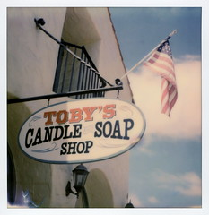 Toby's Candle & Soap (tobysx70) Tags: the impossible project tip polaroid sx70sonar sonar instant color film for sx70 type cameras impossaroid tobys candle soap shop old town san diego ca california sign us usa flag stars stripes blue sky clouds ogfc polawalk 081116 toby hancock photography