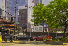 Urban View Of Westside Manhattan (nrhodesphotos(the_eye_of_the_moment)) Tags: dsc00356160 wwwflickrcomphotostheeyeofthemoment nrhodesphotosyahoocom construction cranes pylons westside manhattan nyc 12thavenue chelsea buildings transportation summertime season autos cars windows metal reflections shadows skyscrapers skyline glass streetlights trees urban curb crosswalk outdoor signs fence plant plantlife