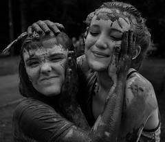 Mud-wrestle? (Nikonsnapper) Tags: olympus omd em1 zuiko 1240mm cardiff mud 5k run girls muddy wrestle bw