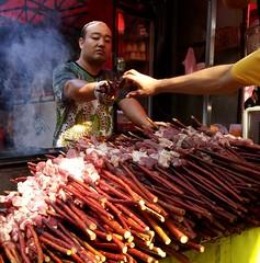 BBQ seller, Xi'an (MarcoFlicker) Tags: china bbq seller skewers meat xian