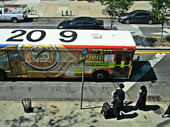Bus is Here! (Robert S. Photography) Tags: street above subway busstop brooklyn boropark sign bus yidish people hasidim luggage travel waiting sidewalk cars trashcan sunshine city scene canon powershot elph160 color iso200 nyc august 2016