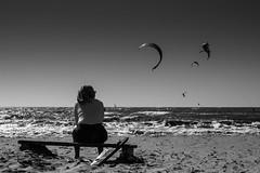Kitesurfers (parenthesedemparenthese@yahoo.com) Tags: dem alone bw backlighting beach bench blackwandwhite ete femme nb noiretblanc woman banc blancoynegro bn byn contrejour cote grece greece kitesurfers lunettesdesoleil mer plage sea seashore seule summer sunglasses