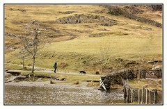 Dog Walking in the Lake District (Audrey A Jackson) Tags: canon60d lakedistrict nature countryside person dog walking mountains water fencing trees rocks gate 1001nights
