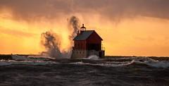 Grand Haven sunset (Calvin Morgan) Tags: grandhavenmichigan lighthouse lakemichigan nikond700 nikon70300 waves stormy sunset