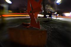 DSC_1139-2 (glhs279) Tags: park longexposure winter red sculpture distortion blur lensbaby newjersey essexcounty nj wideangle streetscene nighttime publicart montclair lightstreaks nightimage uppermontclair