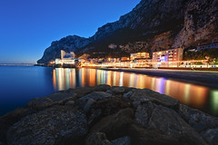 Catalan Bay Gibraltar (Allard Schager) Tags: houses winter light sunset mountain seascape beach nature water beautiful rock architecture reflections landscape zonsondergang sand nikon warm europe december surreal cliffs illuminated shore vista bluehour gibraltar mediterraneansea gettyimages 2012 iberianpeninsula waterscape extremewideangle 14mm photomatix digitalblending nikcolorefexpro catalanbay caletahotel d700 britishoverseasterritory nikond700 nikkor1424mmf28 nikonfx allardone allard1 fullframepower allardschagercom