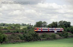 M002-00019 (railphotolibrary.com) Tags: trees modern train countryside diesel railway sunny junction signal swt dmu worting battledown
