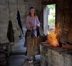 Blacksmith at forge (sailronin) Tags: florida flame charcoal blacksmith forge sparks bellows 35mmsummicron leicam9 historicsaintaugustine
