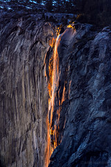 Horsetail Fire Falls (CNaene) Tags: california trees light sunset shadow sunlight mountain rock fire golden glow touch reflect granite yosemitenationalpark fiery horsetailfalls lavalike firefalls snowtopped midfebruary