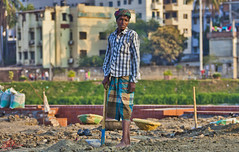 Paving the streets (Ausamah) Tags: poverty pakistan india color colour art photography bahrain labor indian poor arabic arab barber labour tuktuk worker dhaka arabian tuk bangladesh bahraini labourer subcontinent    ausamah alabsi