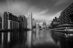 pan peninsula (vulture labs) Tags: street city uk longexposure travel bridge light england sky urban blackandwhite bw 6 white black reflection building london art water monochrome thames skyline architecture modern clouds skyscraper reflections river landscape photography photo 3d movement nikon europe long exposure cityscape angle very crane fineart capital wide monotone monochromatic stop filter wharf daytime pan canary nikkor peninsula cloudscape cloudporn density cityoflondon lightroom waterscape neutral londonskyline onecanadasquare daytimelongexposure 10stop lr4 nd110 d700 nd106 vulturelabs