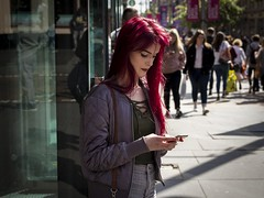 Go Bold (Leanne Boulton) Tags: outdoor urban street candid portrait portraiture streetphotography candidstreetphotography candidportrait streetlife young woman female pretty face facial expression girl beauty beautiful red redhead hair dye bright colorful colourful tone texture detail depthoffield natural sunlight backlit light shade shadow city scene human life living humanity people society culture fashion canon 7d 50mm color colour glasgow scotland uk