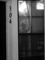 Phantom (Vincent F Tsai) Tags: reflection window ghostly image person photographer home self selfportrait creepy blackandwhite monochrome minolta panasonic g7